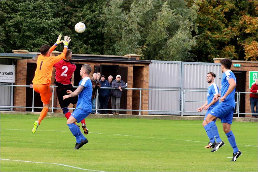 The collision as Rob Partington leaps for the ball