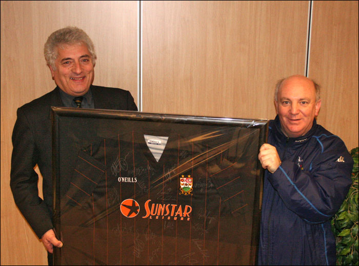 John Elliott is presented with a Barnet shirt after a famous Herts Senior Cup tie Win in 2005