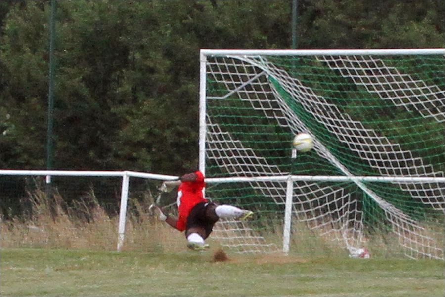 Noyes shot hits the net giving the Colney keeper no chance