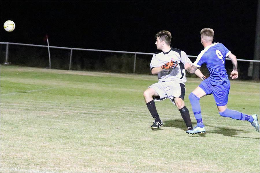Lee Armitt watches his goal go in