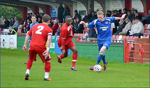 Lewis Putman works the ball forward down the left wing