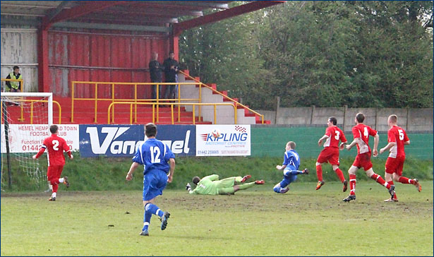 Lewis Putman goes close with the Hemel defence chasing back