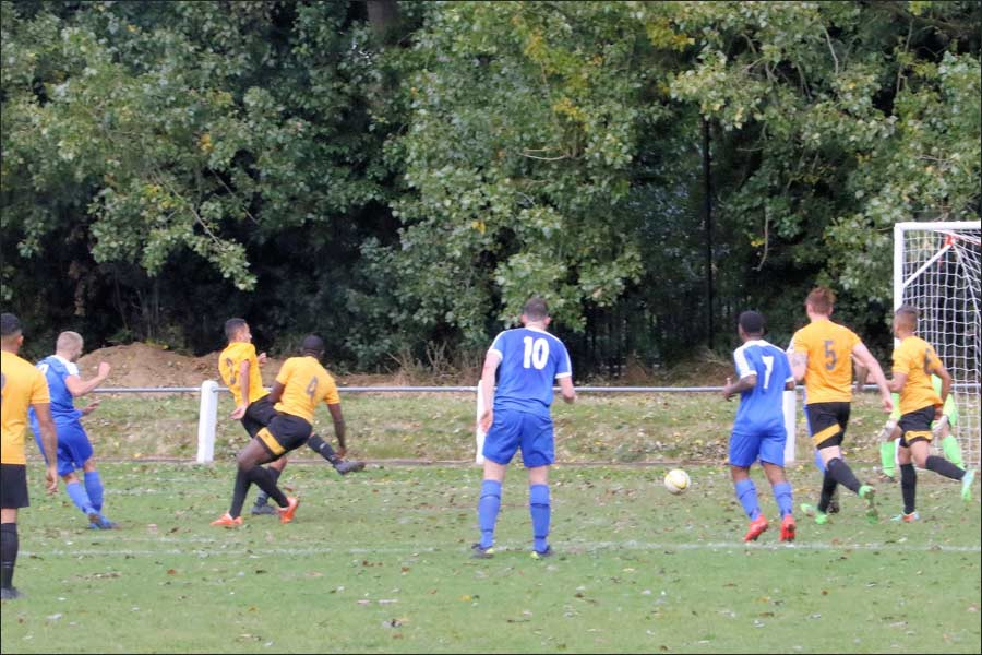 Scott Pugsley shot is parried by the Stotfold keeper but breaks to Luke wells who scores