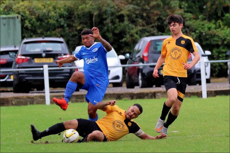 Young Luis Mateus breaks through a Stotfold tackle