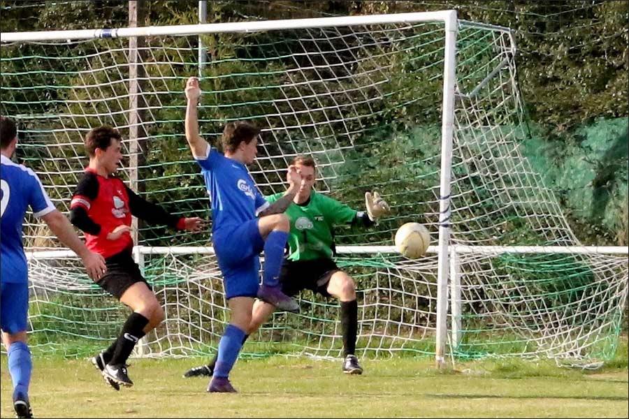 Luke Wells beats the keeper but its the post again