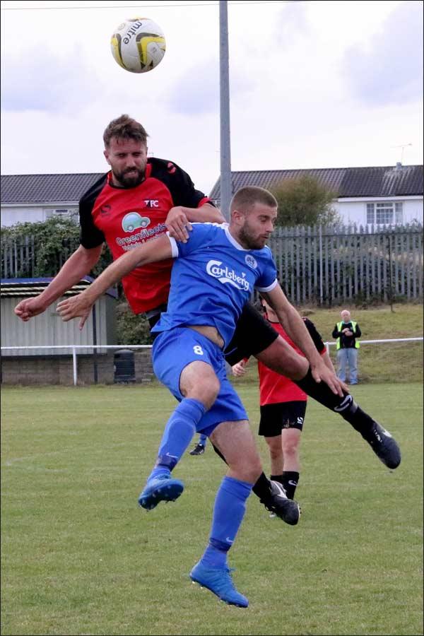 Scott Pugsley battling hard in midfield