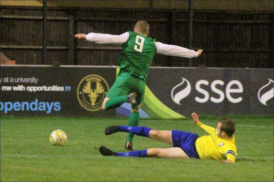 Oliver Cole is brought down for the penalty