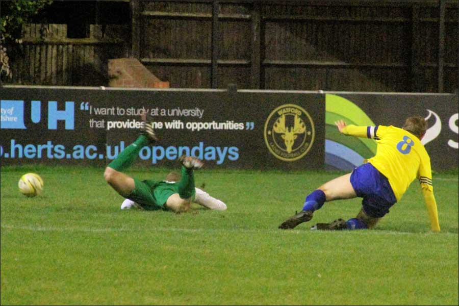 No doubt about the penalty as Oliver Cole goes flying