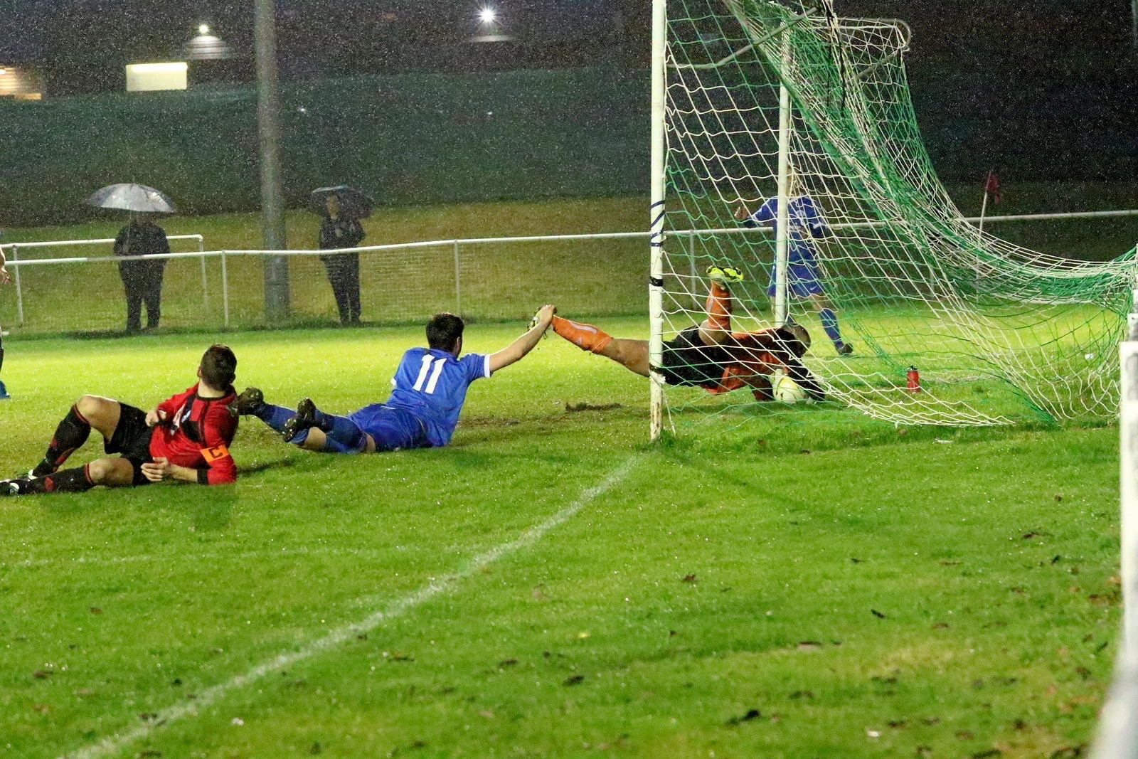 Ian Hurst sees his shot go over the line as the Edgware keeper desperately tries to save