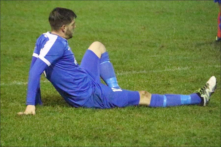 Unfortunate Adam Lowton suffers a bad foot injury
