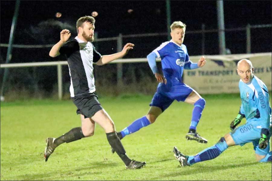 Lee Armitt slides his shot past the Berkhamsted keeper