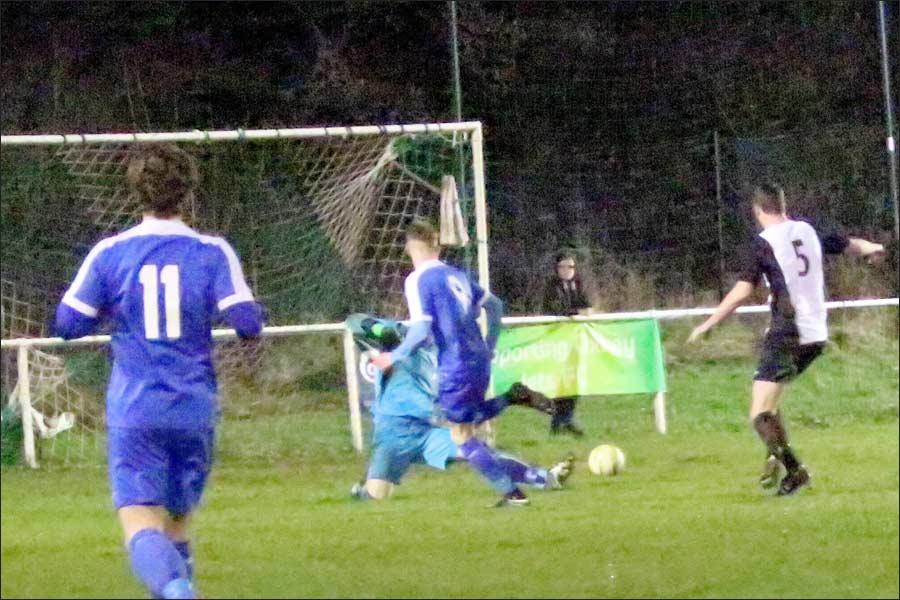 Lee Armitt's shot heads for the net