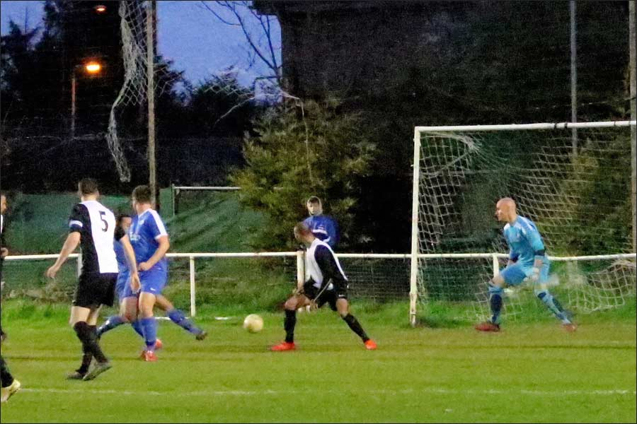 Chris Blunden (partly hidden) hits the inside of the post